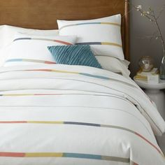 Inspired by classic shirt stripes, Steven Alan designed this handcrafted bedding in collaboration with Eco Tasar, a cooperative that supports rural Indian spinners and weavers. Made of 100% cotton, the duvet's neutral backdrop is punched up with a hint of rich woven color.