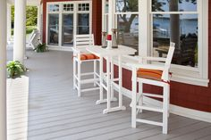 Relax in the shade with this outdoor bar set. Eco-friendly outdoor furniture. #MadeInUSA using recycled plastic!