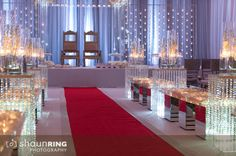 Crystal and red carpet aisle with white draping for Hindu ceremony via IndianWeddingSite.com