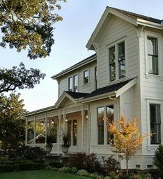 Farmhouse with front porch. Check the window trim detail. Also, simple peak at entrance.