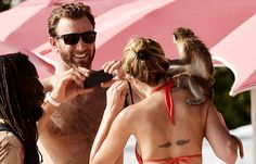 Golfer Dustin Johnson takes a picture of girlfriend Paulina Gretzky (daughter of hockey great Wayne Gretzky) with a monkey in Barbados.