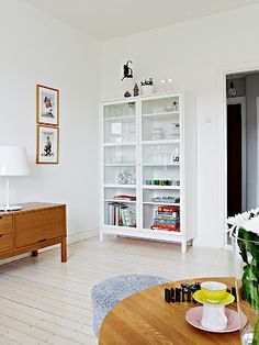. interior design, glass doors, display cabinets, white walls, vintage furniture, white cabinets, ikea, interior decor, painted floors