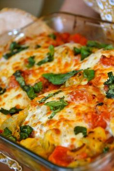 Italian Chicken; Fresh, ripe Roma tomatoes, artichokes, cheeses and basil baked over protein-rich chicken... looks amazing!