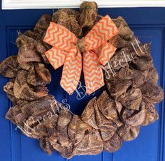 Camo burlap wreath with orange chevron bow by DoorDecorByMichelle, $45.00