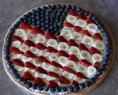 Flag Fruit Pizza: sugar cookie dough crust, cream cheese/cool whip, fruit, orange juice flavored glaze