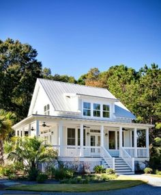 Simple white house with wrap-around porch.  I never wanted a giant house.  My dream home has always had  wrap around porch though.