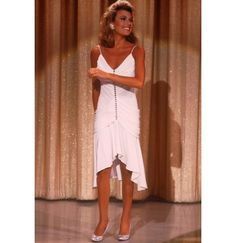 In a lovely white frock in the '80s.