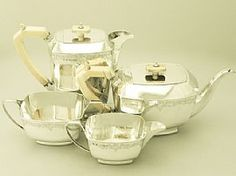 A fine and impressive antique George V English sterling silver and ivory handled four piece tea and coffee service in the Art Deco style; an addition to our silver teaware collection. SKU: W9243 Price: GBP £2,450.00 http://www.acsilver.co.uk/shop/pc/Sterling-Silver-Four-Piece-Tea-and-Coffee-Service-Art-Deco-Style-Antique-George-V-67p6456.htm#.VAnVBc90zcs