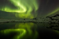 """Stunning Space WeatherCredit: Atli Arnarson, atlapixThe northern lights glow an otherworldly green above southwest Iceland on Jan. 22, boosted by an especially active sun. Auroras, visible mostly at very high and very low latitudes, occur when charged particles from the sun hit atoms in the upper atmosphere, creating curtains of light which often shift and undulate.  """"The show on the 22nd was the largest I've seen in recent years, maybe in the last 20 years,"""" photographer Atli Arnarson told LiveScience. """"The pictures don't really do it justice. They were quite active at times, and danced across the sky"""