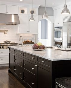 black cabinets, counters and lights