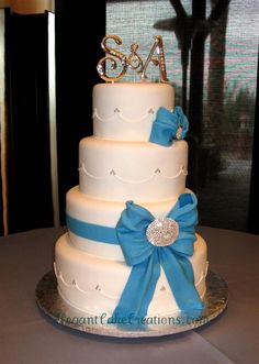 ooooh! pretty .. love the dainty scallops topped with silver dots. The bows are beautifully made - by Elegant Cake Creations : http://www.elegantcakecreations.com/Pages/WeddingCakes.aspx#