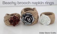 Beachy Brooch Napkin Rings - temporarily use brooches to dress up napkin rings for a party