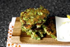 Broccoli Parmesan Fritters - 8 ounces (1 small-to-medium bundle, 225 grams) fresh broccoli (3 cups chopped)  1 large egg  1/2 cup (65 grams) all-purpose flour  1/3 cup (30 grams) finely grated parmesan cheese  1 small clove garlic, minced  1/2 teaspoon Kosher salt, plus more to taste  A pinch of red pepper flakes or several grinds of black pepper  Olive or vegetable oil for frying