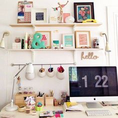 Cute, feminine home office styling. Love the framed art prints.
