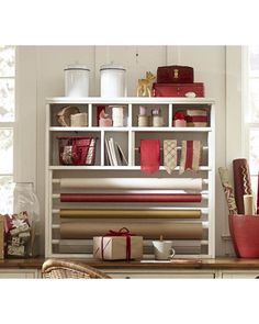 Wow, check out this wrapping paper hutch! Get it here: http://www.bhg.com/shop/pottery-barn-whitney-wrapping-paper-hutch-p5257e5a2e4b0c13d45cf31f2.html