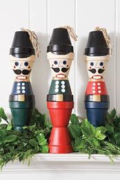 I have seen toy soldiers done out of the clay pots, but not nutcrackers!  Very cute!!