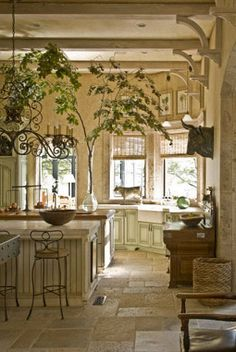 Wonderful beams with brackets... So much to love in this Kitchen.  French Country kitchen off white