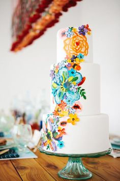 Floral painted wedding cake.