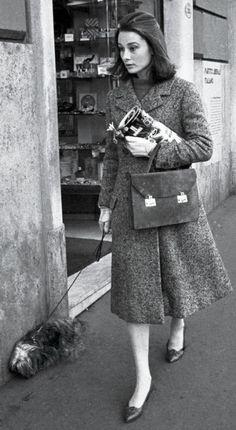 Audrey Hepburn, 1959, coat: Balenciaga., handbag: Hermès, shoes: Salvatore Ferragamo.