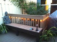 Outdoor room bench made out of PVC/composite decking remnants and wood in front of balustrade hiding A/C unit.