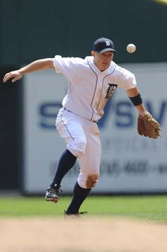 Brandon Inge bobbles the ball but still makes an out in the first inning. (Elizabeth Conley/The Detroit News)