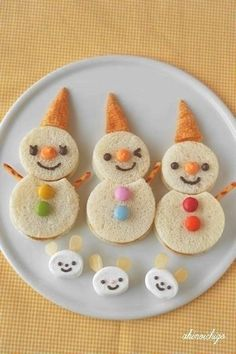 Cut sandwiches into snowmen and top with Bugles.