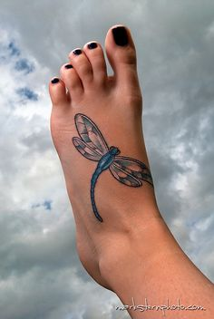 dragonfly foot tattoo.   Love.