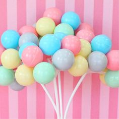 circus theme cake/cake pops.  make them primary colours to represent balloons