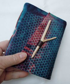 Hand felt and leather wrapped Journal by chad alice hagen;   The unique closure on this book is created from recycled leather and a hand carved found stick.
