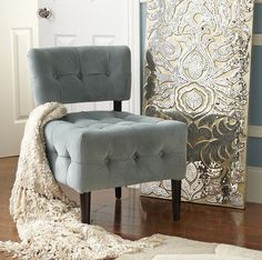 Turn up the glam factor with a Pier 1 Mirrored Damask Panel and Fionn Chair in Blue Velvet