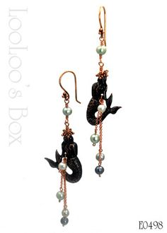 These are must have's!  Find them at LooLoo's Box at Etsy!  Rusty black mermaids...oh my!