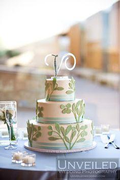 mint green, white wedding cake  Unveiled Photography