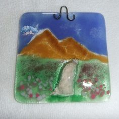 This beautiful cremation sun catcher is made to order and handcrafted in my studio in the USA. It's the perfect way to honor your beloved pet or loved one.  Each one will have a mountain and wild flower meadow with flower colors of your choice. The ashes form what looks like a gravel pathway through the meadow and up to the mountains. The final touch is the dichroic rainbow in the sky by addicted2glassfusion, $100.00