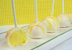 Lemon-Raspberry Cheesecake Pops - You will need: 2 (16 oz.) packages Vanilla CANDIQUIK® Coating,  2 (8 oz.) packages Cream Cheese, softened,  1 packet (3.4 oz.) Jell-O Lemon Instant pudding/pie filling, 1 tsp. Raspberry Extract (optional)