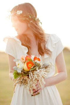 An ivy and flower wreath replaces the traditional veil. Beautiful.