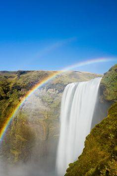 rainbow and waterfall in Skogar, Iceland