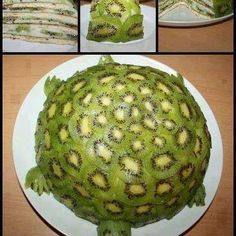 """Fruity Turtle Cake ♥  from:Live Love Fruit  RECIPE:  Peeled, and thinly sliced kiwis (as many as it takes to cover shell)  Bananas, thinly sliced, lengthwise  Coconut flesh (1/2 cup)  Coconut water (1/4 cup)  Dates, pitted (1/2 cup)    Put coconut flesh, coconut water, and dates into a blender, and blend on high until you get an """"icing"""" like consistency (not too liquidy, if it is too thin, add more dates)  Layer bananas and frosting until half sphere then cover with kiwi for shell"""