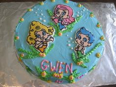 Bubble Guppies - Chocolate cake with FBCT of Bubble Guppie characters. all buttercream icing.