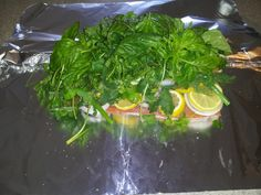 Super easy, super healthy, super delicious salmon!  One piece salmon seasoned lightly with salt & pepper, layererd with onion slices, lemon slices, and one whole bunch of each: green onions, cilantro,dill, & basil. Wrap in foil pouch, grill on bbq for 10-12 min until fish is done!