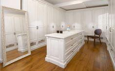 silver floor mirror, wall to wall cabinetry