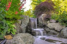 Rock garden and boulders give this water feature h...
