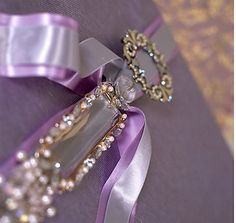 "Wrapping Lavendar Ribbons Pin Present ~ this is an elegant wrap. You do not have to use brooches (which can be found at thrift stores) you can also find some pretty ""Hair Bobs"" to fasten to the ribbons."