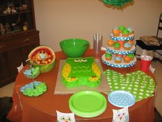 Baby shower cake table idea.  Was for a boy went w/ orange, green, and blue.