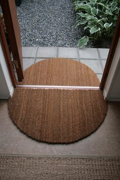 DIY Dirt Prevention Mat : cut a round mat cut in half to use as an inside / outside prevention from bringing dirt into your house... very smart!