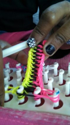 My friend destiny showed me this really cool way to make a rubberband braclet