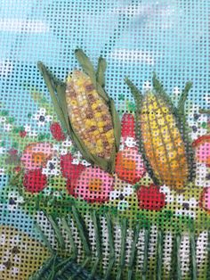 This corn was made by inserting a small straw into flair and then putting beads into the straw.