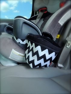 car seat caddy. this link is to an etsy store where you can buy it, but i'm sure i could figure out how to make one...