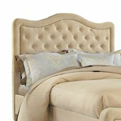 """Button-tufted velveteen headboard with nailhead trim.   Product: HeadboardConstruction Material: Wood and polyesterColor: BuckwheatFeatures:  Nailhead trimButton-tufting Dimensions: Queen: 50.25"""" H x 65"""" W x 4.25"""" DKing: 50.25"""" H x 80.25"""" W x 4.25"""" DNote: Includes headboard only"""