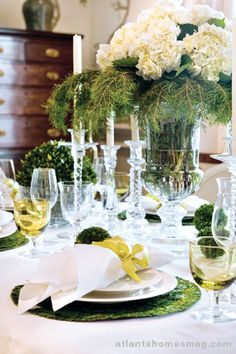 White flowers with greenery holiday centerpieces, green christmas, christmas tables, christmas tabletop, table scapes, decorating tables, christmas table settings, holiday tables, frou frou