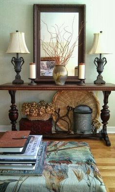 The Best of Both Worlds: Frugality and Fun: LIVING ROOM DECORATED ON A BUDGET   Not my style, but really like the objects as to how they are placed. It is really balanced.